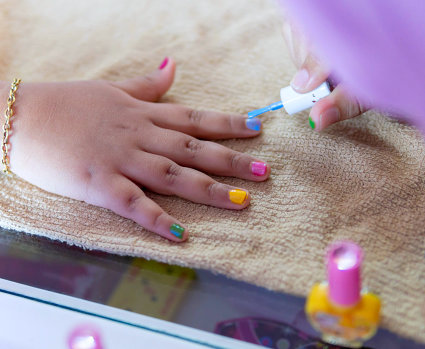 little girl gets nails polished.