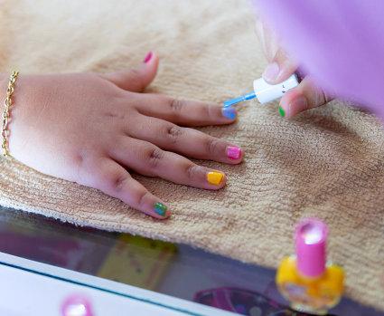 little girl gets nails polished.