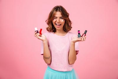 teenager holding nail polishers